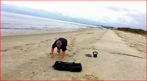 Total Body Beach Workout: Sandbag Presses And Bear Crawls