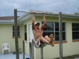 the-mango-man-on-his-pull-up-bar-in-backyard-obs-4-30-10