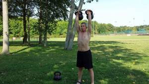Double kettlebell overhead carries will drive your fitness to new heights