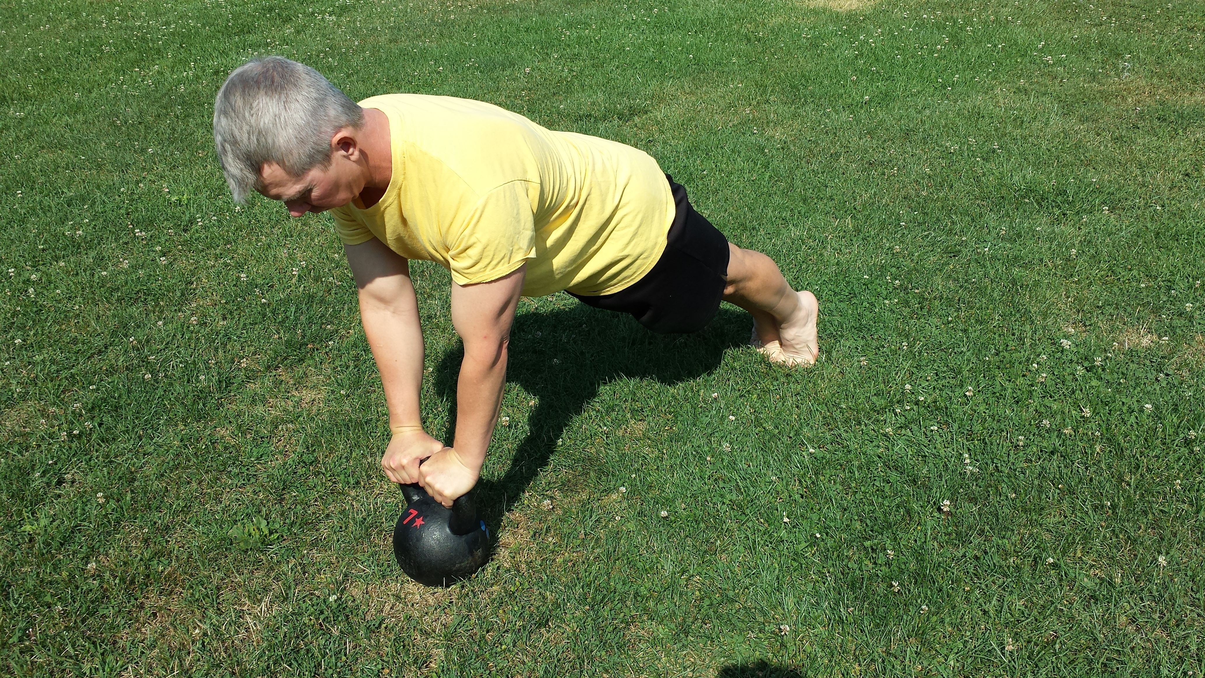 mark mellohusky kettlebell plank outdoor workout seven stars fitness