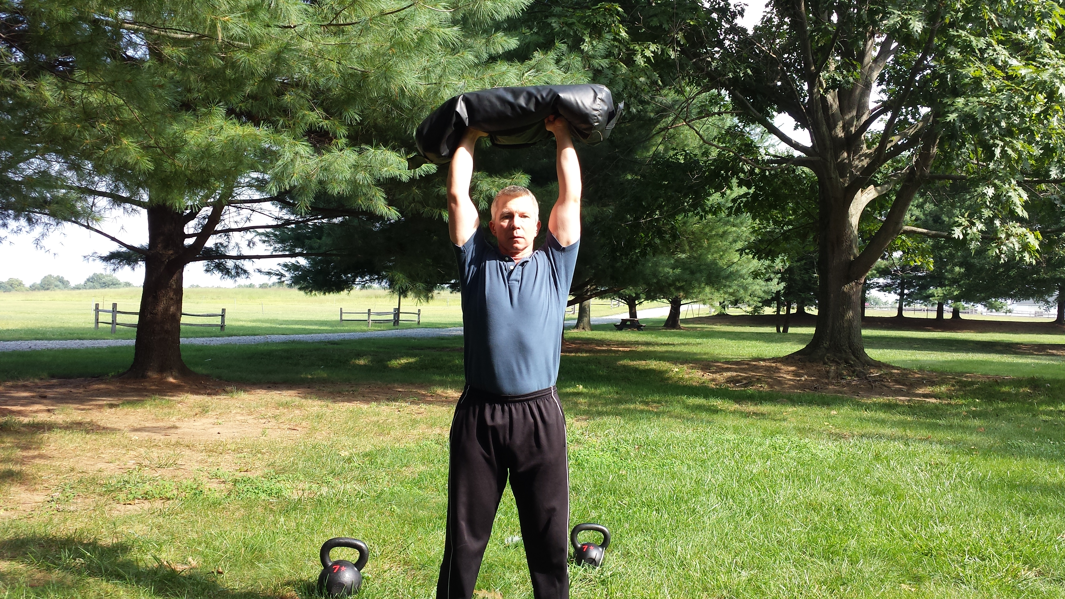 mark mellohusky mobility exercises ultimate sandbag exercises seven stars